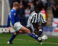 Photo. Matthew Lewis.<br />Leicester City v Newcastle United. FA Barclaycard Premiership. 26/12/2003.<br /><br />Leicester's James Scowcroft tackles Newcastle's Olivier Bernard.