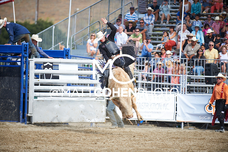 Bull rider Wes Silcox of Santaquin, UT rides 1072/5 Wolf Deer at the Rancho Mission Viejo Rodeo in San Juan Capistrano, CA.  <br /> <br /> <br /> UNEDITED LOW-RES PREVIEW<br /> <br /> <br /> File shown may be an unedited low resolution version used as a proof only. All prints are 100% guaranteed for quality. Sizes 8x10+ come with a version for personal social media. I am currently not selling downloads for commercial/brand use.