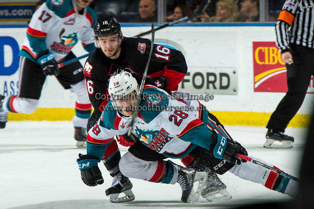 KELOWNA, CANADA - FEBRUARY 8: Ryan Schoettler #16 of the Prince George Cougars checks Leif Mattson #28 of the Kelowna Rockets to the ice during second period on February 8, 2019 at Prospera Place in Kelowna, British Columbia, Canada.  (Photo by Marissa Baecker/Shoot the Breeze)