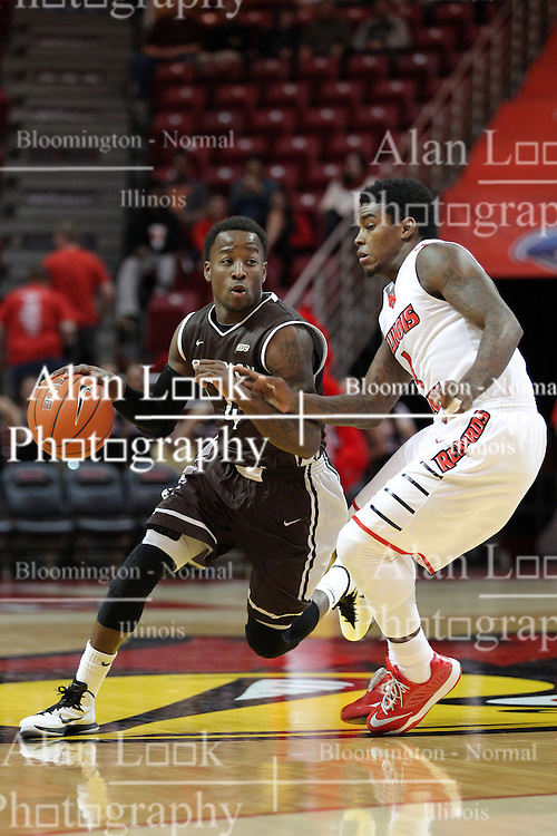29 December 2014:  Thomas Jackson drives past half court guarded by Bobby Hunter during an NCAA non-conference interdivisional exhibition game between the Quincy University Hawks and the Illinois State University Redbirds at Redbird Arena in Normal Illinois.