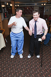 Man with disability with carer enjoy dancing on holiday in Blackpool..(Not cleared for newspaper and television use)