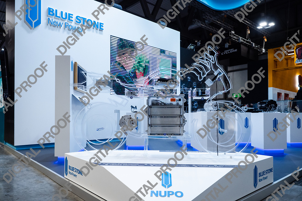 r\RHO Fieramilano, Milan Italy - November 07, 2019 EICMA Expo. Electric motor technology for motorcycles stand from Nupo Blue Stone New Power at EICMA 2019