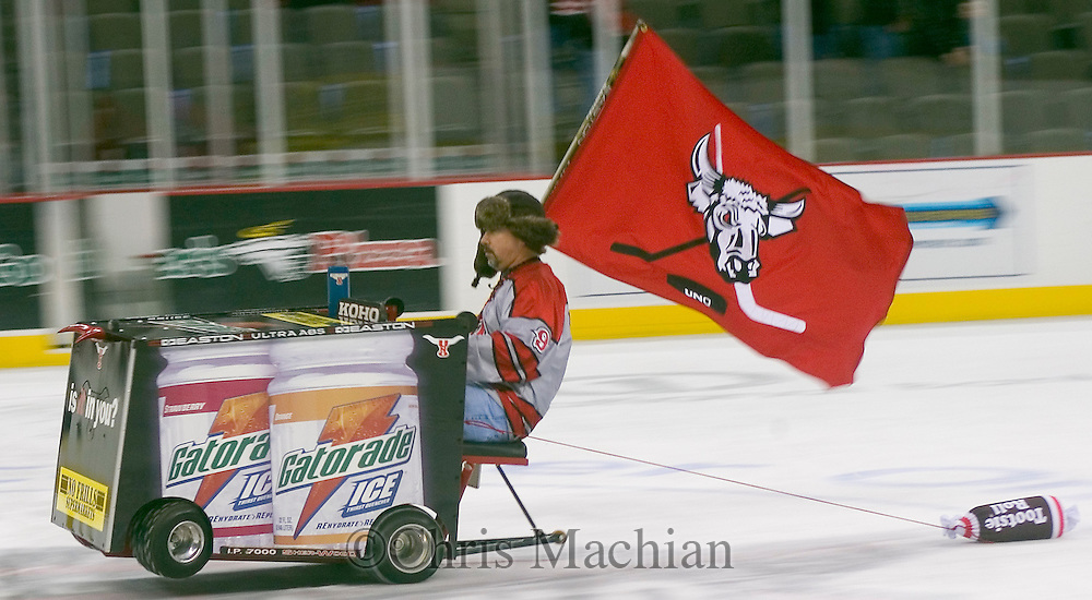"""1/13/07 -- Omaha, NE.University of Nebraska at Omaha fan Greg McVey rides with his """"Mavboni"""" to entertain the crowd before a game against Bowling Green State University Saturday night at Qwest Center Omaha..Many UNO fans believe the Bowling Green uniforms look like Tootsie Rolls...Photo by Chris Machian/Prairie Pixel Group"""