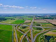 Nederland, Gelderland, gemeente Beuningen; 14–05-2020; Knooppunt Ewijk,klaverturbineknooppunt. Kruising A50(richting Eindhoven naar boven), met A73(vanuitVenlo)en de autowegN322(Druten, naar rechts).<br /> Ewijk junction, clover turbine junction. A50 junction (Eindhoven-Emmeloord), with A73 (from Venlo) and the N322 motorway (Druten).<br /> <br /> luchtfoto (toeslag op standaard tarieven);<br /> aerial photo (additional fee required)<br /> copyright © 2020 foto/photo Siebe Swart