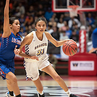 Kirtland Central's Tiajhae (31) drives to the basket while Los Lunas' Marissa Weldon (1) guards, in their 2019 New Mexico 4A Girls Championship game, Friday March 15 at the Dreamstyle Arena in Albuquerque. Los Lunas beat Kirtland Central 49-43.