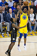 Golden State Warriors forward Andre Iguodala (9) shoots a jumper over the Milwaukee Bucks defense at Oracle Arena in Oakland, Calif., on March 29, 2018. (Stan Olszewski/Special to S.F. Examiner)