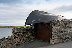Upturned boat forming roof of garage of house  in old town of Lerwick, Shetland Isles, Scotland, UK