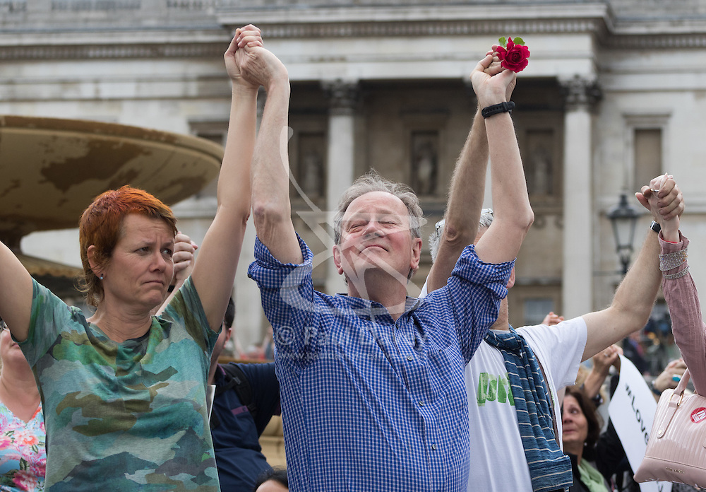 Trafalgar Square, London, June 22nd 2016. Thousands of people flood London's Trafalgar Square to celebrate what would have been slain Labour MP for Batley & Spen Jo Cox's 42nd birthhday. PICTURED: Members of the crowd join hands as they remember Jo Cox.