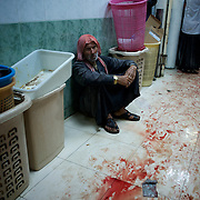 August 10, 2012 - Aleppo, Syria: A syrian man watches in shock the commotion in a improvised hospital, minutes after heavy shelling from the Syrian Army against a bakery in the residential area of Tariq Al-Bab in central Aleppo. At least 12 people have died and more the 20 got injured during the attack...The Syrian Army have in the past week increased their attacks on residential neighborhoods where Free Syria Army rebel fights have their positions in Syria's commercial capital, Aleppo. (Paulo Nunes dos Santos/Polaris)