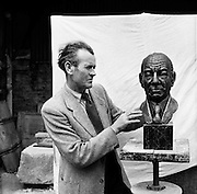Mr Seamus Murphy, Cork - Sculptor .17/07/1958.. Seamus Murphy (1907-1975).One of the giants of Cork art, and an important figure in the 20th century history of Irish art, Seamus Murphy was a traditional sculptor, best known for his ecclesiastical limestone statues and portrait heads. Influenced at an early stage in his life by intellectual revisionist Daniel Corkery, his most notable works include Saint Brigid and the Twelve Apostles, San Francisco, ras an Uachtar in Dublin and the United Nations Monument in Glasnevin, Dublin...Murphy was born in 1907 near Mallow in Cork, his father James Murphy was a railway employee. He attended St. Patrick's National School in Cork between 1912-1921, where he became the pupil of Daniel Corkery who gave him his first drawing lessons. In 1921, on the advice of Corkery, he entered the Crawford School of Art to study modelling..Between 1922-1930 he became an apprentice stone carver at John Aloysius O'Connor's Art Marble Works, Cork. Murphy started his career at a difficult time for visual arts in Ireland. The country had just been through a war for Independence and a Civil war, and art was not a priority for the newly formed government. Funds from state and private individuals were scarce, Murphy lacked the contacts of Dublin sculptors like Albert Power, and headstones, the bread-and-butter of a stone mason's life, were starting to be mass-produced by machinery..Conservatism dominated Ireland for decades, but despite this, Murphy, ever an optimist, was able to forge a career for himself. His first break came in 1931 when he was awarded the Gibson Bequest Scholarship Exhibits at the Royal Hibernian Academy Exhibition. In 1932 he studied at the Acadamie Colarossi in Paris for a year under the American Sculptor Andrew O'Connor..In 1934 he returned home and opened a studio and stoneyard in Blackpool, Cork. His first commissions included Clonmult Memorial at Midleton, 2 statues for Bantry Church, and a carved figure of St Gobnait in Bally