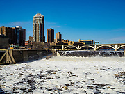 29 MARCH 2019 - MINNEAPOLIS, MN:   Winter snow melt causes the Mississippi River at St. Anthony Falls in Minneapolis to run above flood stage. The Minnesota Highway 65 bridge over the river is in the background. The Mississippi River through the Twin Cities has already hit flood stage. Several roads and parks in St Paul are already closed in anticipation of higher flood levels. Weather forecasters and hydrologists have backed off a little on earlier predictions of severe flooding because the snow melt has been slower than expected.      PHOTO BY JACK KURTZ