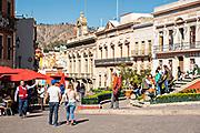 The busy Plaza of Peace or Plaza de la Paz in the historic center of Guanajuato City, Guanajuato, Mexico.