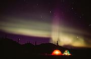 Alaska. Winter camping with tent under the Aurora Borealis.
