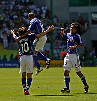Photo: Glyn Thomas.<br />Australia v Japan. Group F, FIFA World Cup 2006. 12/06/2006.<br />Japan's Shunsuke Nakamura (L) celebrates giving his team a 1-0 lead.