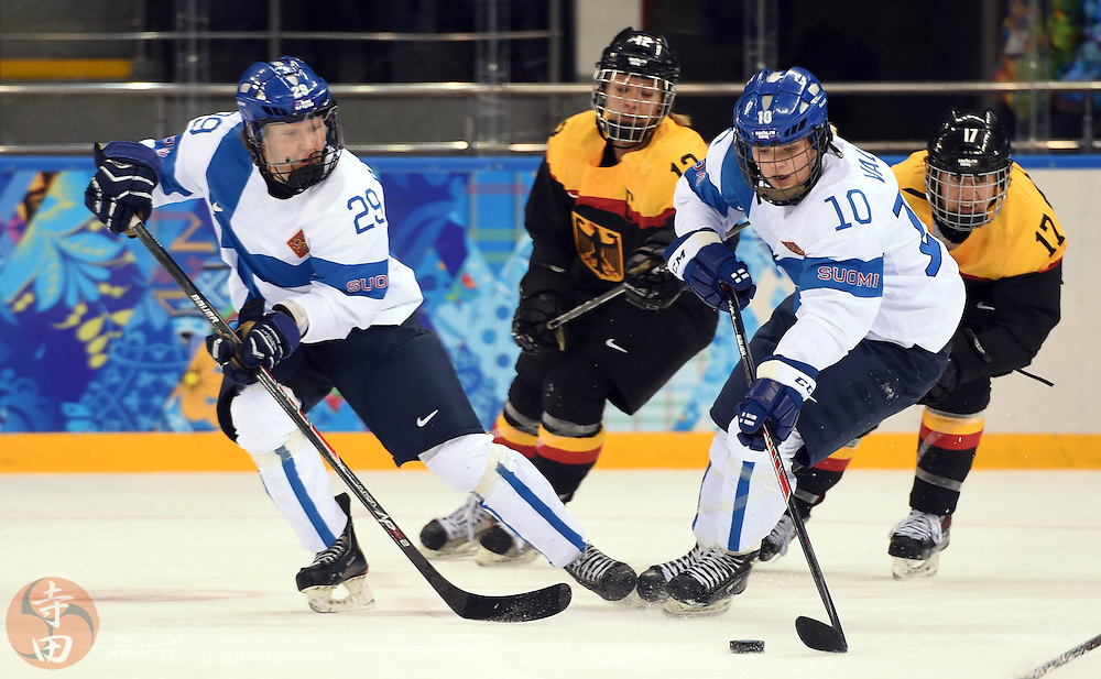 Feb 16, 2014; Sochi, RUSSIA; Finland forward Linda Valimaki (10) skates with the puck against Germany in the women's ice hockey classifications round during the Sochi 2014 Olympic Winter Games at Shayba Arena.