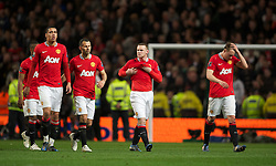 MANCHESTER, ENGLAND - Monday, April 30, 2012: Manchester United's players Chris Smalling, Ryan Giggs, Wayne Rooney and Phil Jones look dejected after losing the Premiership match against Manchester City 1-0 at the City of Manchester Stadium. (Pic by David Rawcliffe/Propaganda)