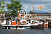 Old, traditional boats and ships in the city of Trondheim, Norway.