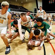 Point Loma players celebrate after Point Loma guard Brock Mackenzie's jump shot at the buzzer defeated Biola fo win the PacWest basketball championship finals in the Felix Event Center at Azusa Pacific University Saturday, March, 7, 2020, in Azusa. (Mandatory Credit: Christina Leung-Sports Shooter Academy)