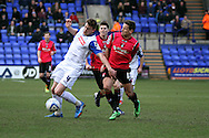 Tranmere Rovers' Ash Taylor holds off Oldham Athletic's Charlie MacDonald. Skybet football league 1match, Tranmere Rovers v Oldham Athletic at Prenton Park in Birkenhead, England on Saturday 1st March 2014.<br /> pic by Chris Stading, Andrew Orchard sports photography.