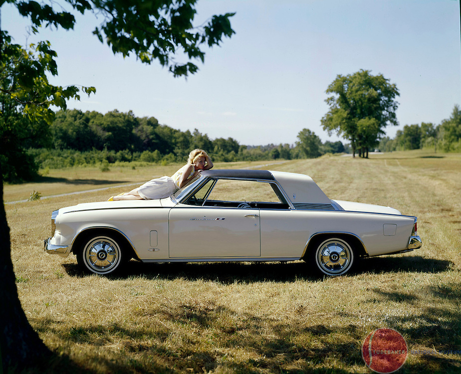 A 1964 Studebaker Gran Turismo Hawk is shown in this factory publicity image.