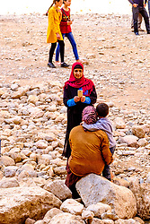 A woman taking a photograph with a phone in the Todra Gorge. Morocco<br /> <br /> (c) Andrew Wilson   Edinburgh Elite media