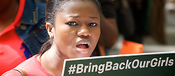 """276 girls were seized from their school in the village of Chibok, in Borno state, north Nigeria, by Boko Haram militants, 53 managed to escape. It is feared that the remaining girls will be sold by the group. <br /> <br /> A group called """"Bring Back Our Girls,"""" which is comprised of relatives of the missing students, have staged regular protests across Nigeria calling for the government and military to do more to find the girls. Currently 234 girls are still missing. This was the first London protest outside the Nigerian High Commission in Northumberland Avenue, London, United Kingdom. 5th May 2014. <br /> <br /> pictured are protestors and outside the High Commission door is: <br /> Lola Bello - who leads a charity to educate Nigerian children in the UK called Path to Possibilities based in Trent Park, Enfield, EN4 0PS info@pathtopossibilities.co.uk www.pathtopossibilities.co.uk <br />  <br /> with Mohammed Usman who comes from the region where the girls disappeared  from."""