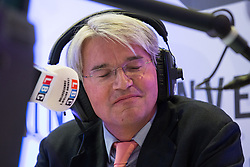 © Licensed to London News Pictures . 26/03/2014 . London , UK . ANDREW MITCHELL talking on LBC radio in the spin room after the debate . Liberal Democrat leader and Deputy Prime Minister , Nick Clegg and UKIP leader Nigel Farage , hold the first of two head to head debates on Britain's future in Europe , hosted by LBC Radio , at 8 Northumberland Avenue in London . Photo credit : Joel Goodman/LNP