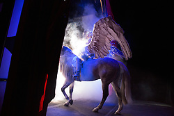 """Tatiana Tchalabaev, of The Thundering Cossack Warriors, enters the arena on Pegasus.<br /> <br /> Ringling Bros. and Barnum & Bailey Circus started in 1919 when the circus created by James Anthony Bailey and P. T. Barnum merged with the Ringling Brothers Circus. Currently, the circus maintains two circus train-based shows, the Blue Tour and the Red Tour, as well as the truck-based Gold Tour. Each train is a mile long with roughly 60 cars: 40 passenger cars and 20 freight. Each train presents a different """"edition"""" of the show, using a numbering scheme that dates back to circus origins in 1871 — the first year of P.T. Barnum's show."""