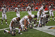September 05 2009    Missouri players kneel in prayer before the start of the second half.   The University of Missouri hosted the University of Illinois in the annual Arch Rivalry Football Game at the Edward Jones Dome in downtown St. Louis on September 5, 2009.  The Mizzou Tigers won, 37-9...            *******EDITORIAL USE ONLY*******