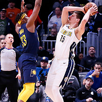 03 April 2018: Indiana Pacers center Myles Turner (33) defends on Denver Nuggets center Nikola Jokic (15) during the Denver Nuggets 107-104 victory over the Indiana Pacers, at the Pepsi Center, Denver, Colorado, USA.