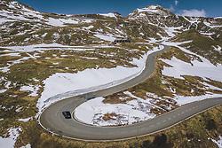 THEMENBILD - ein Auto auf der Strasse mit der schneebedeckten Berglandschaft. Die Hochalpenstrasse verbindet die beiden Bundeslaender Salzburg und Kaernten und ist als Erlebnisstrasse vorrangig von touristischer Bedeutung, aufgenommen am 27. Mai 2020 in Fusch a.d. Glstr., Österreich // a Car drives on the road with the mountain landscape covered with Snow. The High Alpine Road connects the two provinces of Salzburg and Carinthia and is as an adventure road priority of tourist interest, Fusch a.d. Glstr., Austria on 2020/05/27. EXPA Pictures © 2020, PhotoCredit: EXPA/ JFK