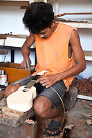 """Making Ukulele at Alegre Guitars, Cebu - Though pre-colonial Visayans had a variety of string instruments which used a coconut shell or gourd as resonator - the guitar is a Spanish introduction. Guitars have been made in Cebu since the Spanish period mainly as a areplacement for organs for church music until they were later imported. Yet, guitars  developed as a local industry only in the present century, receiving a boost from the government's promotion of cottage industries in the immediate postwar period. In Mactan, the craft of guitar making passes from generation to generation and the industry involves many families, the most prominent of whom is the Alegre and Malingin families whose names have become well-known """"brand names"""" of Mactan or Cebu guitars."""