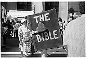 Lady asking question to the 'talking bible' at the 'New York is book County fair' on 5th Avenue from 48-57th street, Sunday 20th September 1992, New York© Copyright Photograph by Dafydd Jones 66 Stockwell Park Rd. London SW9 0DA Tel 020 7733 0108 www.dafjones.com