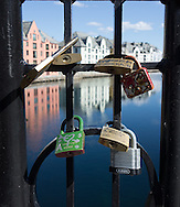 Love padlocks are attached to a railing along the waterfront in Ålesund, Norway, on May 15, 2013.  (© 2013 Cindi Christie)
