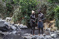 Soufriere, Saint Lucia: Tourists cover themselves in mud from the sulfur springs flowing from inside the collapsed caldera of the volcano on the west coast of Saint Lucia.