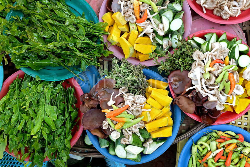 Vegetables for sale at Hua Kua market on the outskirts of Vientiane city, Lao PDR. A large variety of local products are available for sale in fresh markets all over Laos, all being sold on small individual stalls.