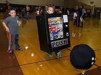 "Vending Machine Benjamin Smith has no choice but to give the bowling ball a ""push"" in the Monster Bowling game at Gilford Middle School's Halloween Party Friday evening.   (Karen Bobotas/for the Laconia Daily Sun)"