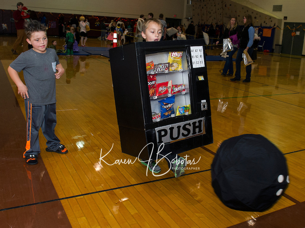 """Vending Machine Benjamin Smith has no choice but to give the bowling ball a """"push"""" in the Monster Bowling game at Gilford Middle School's Halloween Party Friday evening.   (Karen Bobotas/for the Laconia Daily Sun)"""