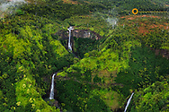 Lush Inland waterfalls during helicopter tour in Kauai, Hawaii, USA