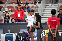 October 6, 2018 - Naomi Osaka of Japan receives medial attention from the trainer during her semi-final match at the 2018 China Open WTA Premier Mandatory tennis tournament (Credit Image: © AFP7 via ZUMA Wire)