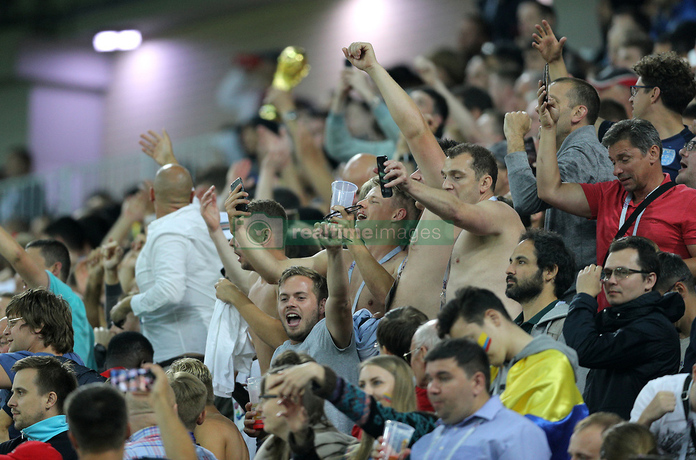 England fans celebrate in the stands as Harry Kane scores hiss ides first goal of the game during the FIFA World Cup 2018, round of 16 match at the Spartak Stadium, Moscow.