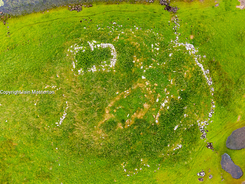 Aerial view from drone of ruin of ancient Norse church near Kildonan on South Uist, Outer Hebrides, Scotland, UK