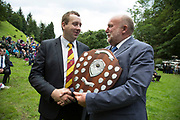 The Hardraw Scaur Brass Band Festival. Winner of the 2015 contest, Elland band, with their leader Daniel Brooks accepting the trophy. Organised by the Yorkshire and Humberside Brass Band Association, the competition is Britain's second oldest outdoor contest and takes place annually in Hardraw Scar in Wensleydale, North Yorkshire, England, UK. The area, a natural amphitheatre, attracts bands from all over the North of England and is a popular event amongst players and audiences alike.