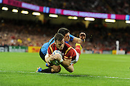 Gareth Davies of Wales beats the tackle from Uruguay's Agustin Ormaechea to dive over and score a try in 2nd half . Rugby World Cup 2015 pool A match, Wales v Uruguay at the Millennium Stadium in Cardiff, South Wales  on Sunday 20th September 2015.<br /> pic by  Andrew Orchard, Andrew Orchard sports photography.