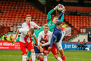 Poland's keeper Kacper Bieszczad bravely collects the ball in a crowded box during the U17 European Championships match between Scotland and Poland at Firhill Stadium, Maryhill, Scotland on 26 March 2019.