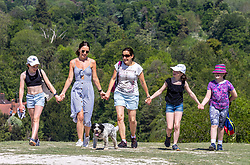 Licensed to London News Pictures. 01/06/2021. Dorking, UK. On the hottest day of the year so far, family and friends from Raynes Park, southwest London enjoy a walk in the sunshine up Box hill in Surrey this morning. The Met Office have forecast very warm weather for the South East and London this week with temperatures predicted to hit up to 26c today and over 27c tomorrow. Photo credit: Alex Lentati/LNP