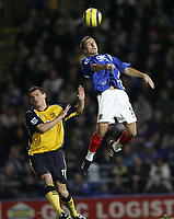 Photo: Lee Earle.<br /> Portsmouth v Wigan Athletic. The Barclays Premiership. 05/11/2005. Portsmouth's Gary O'Neil (R) heads the ball clear from Wigan's Lee McCulloch.