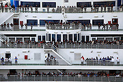 Chinese nationals line the decks of the Grimaldi ferry 'Cruise Roma' after it berthed in Valletta's Grand Harbour February 26, 2011. 2,216 Chinese arrived on the ferry in Malta on Saturday morning from Benghazi, according to local media..REUTERS/Darrin Zammit Lupi (MALTA)
