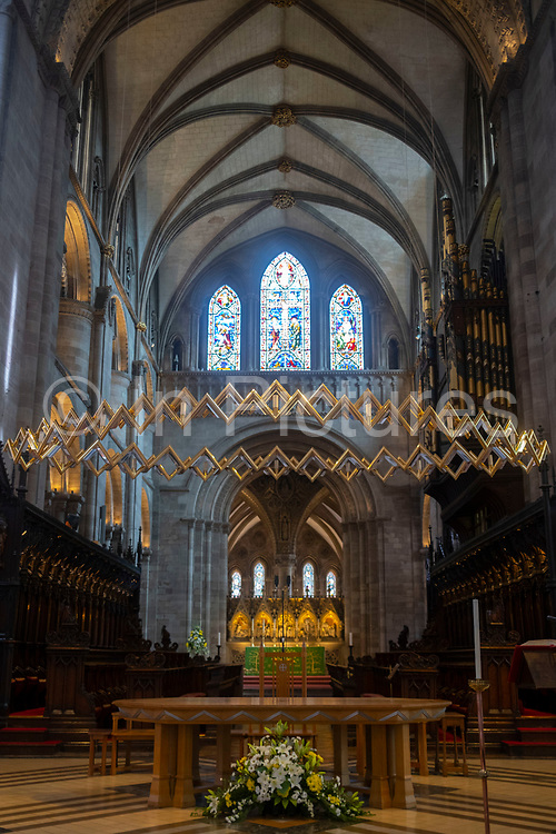 Interior view of Corona, a sculture hanging between the North and South Trancepts depicting a crown of thorns in Hereford Cathedral on 7th June 2021 in Hereford, United Kingdom. Hereford Cathedral is the cathedral church of the Anglican Diocese of Hereford, England. A place of worship has existed on the site of the present building since the 8th century or earlier. The present building was begun in 1079. Substantial parts of the building date from both the Norman and the Gothic periods. The Corona was designed by Simon Beer.