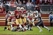 San Francisco 49ers quarterback Colin Kaepernick (7) scrambles from the New England Patriots defense at Levi's Stadium in Santa Clara, Calif., on November 20, 2016. (Stan Olszewski/Special to S.F. Examiner)